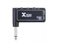 """XVive GA-4  XVIVE GA-4 Mini amplificador de auriculares de metal recargable  Mini amplificador de auriculares para guitarra eléctrica con efecto """"METAL"""".  Batería recargable por USB (cable incluido) con autonomía de 4.5h.  Dimensiones: W81xH75xD15mm  INPUT - Jack para conectar a la guitarra.  STANDBAY / ON / - Enciende o apaga.  AUX - Mini conector estéreo para conectar una fuente de audio externa  GAIN - Ajusta la """"ganancia"""" de la amplificación  TONO - Ajusta el tono  VOLUMEN - Ajusta el volumen general  PHONES - Mini jack para conectar auriculares, altavoces o mesa de mezclas  USB: para cargar la batería"""